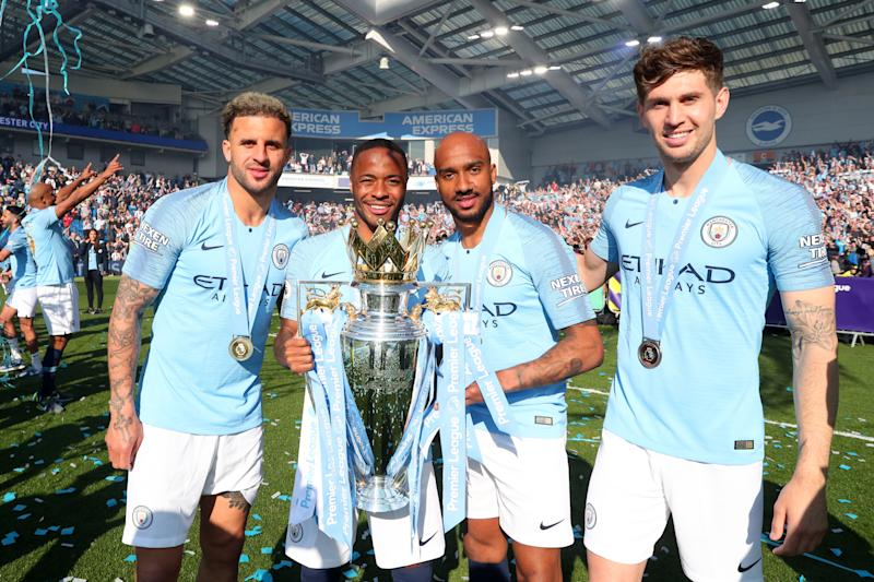 Kyle Walker, Raheem Sterling, Fabian Delph and John Stones with the Premier League Trophy (Photo by Victoria Haydn/Man City via Getty Images)