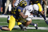 Penn State wide receiver Parker Washington (3) is tackled by Michigan defensive lineman Jaylen Harrell (32), during the first half of an NCAA college football game, Saturday, Nov. 28, 2020, in Ann Arbor, Mich. (AP Photo/Carlos Osorio)