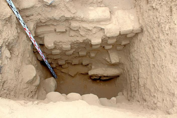Archaeologists dug a trench into the inner crater of the volcano-shaped mound, finding a collapsed stairwell that descended to a mud-plaster floor. <cite>Courtesy of Robert Benfer</cite>