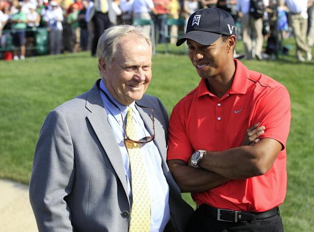 FILE - In this Sunday, June 3, 2012, file photo, Jack Nicklaus, left, talks with Tiger Woods after Woods won the Memorial golf tournament at the Muirfield Village Golf Club in Dublin, Ohio. Having won 14 majors in his career, 2014 is an important year for Woods, as he nears Nicklaus' record of 18 majors won. (AP Photo/Tony Dejak, File)