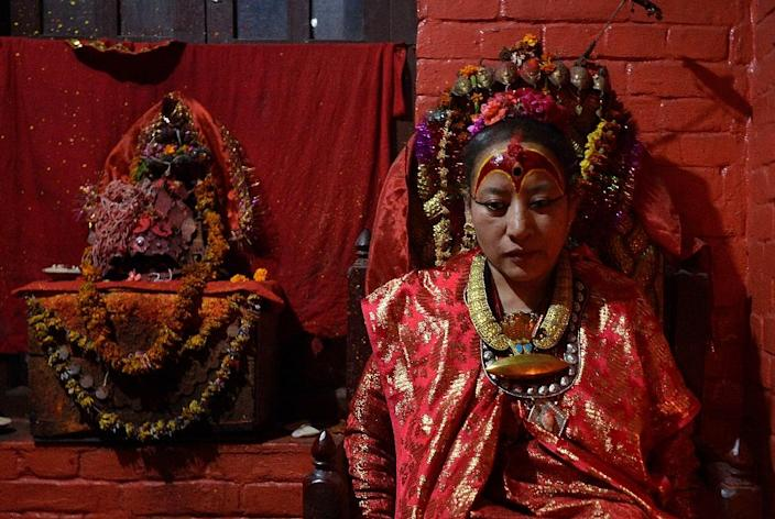 Dhana Kumari Bajracharya, the longest reigning Kumari of Nepal, left her quarters in Kathmandu for the first time in three decades as tremors reduced nearby temples to rubble in April (AFP Photo/Ishara S. Kodikara )