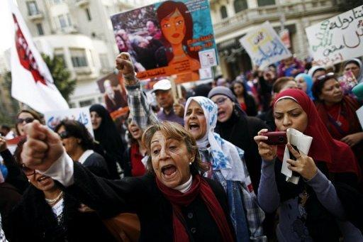 """Egyptians chant slogans as they march in downtown Cairo to mark International Women's Day on March 8, 2013. A UN declaration broke new ground by stating that violence against women could not be justified by """"any custom, tradition or religious consideration."""""""