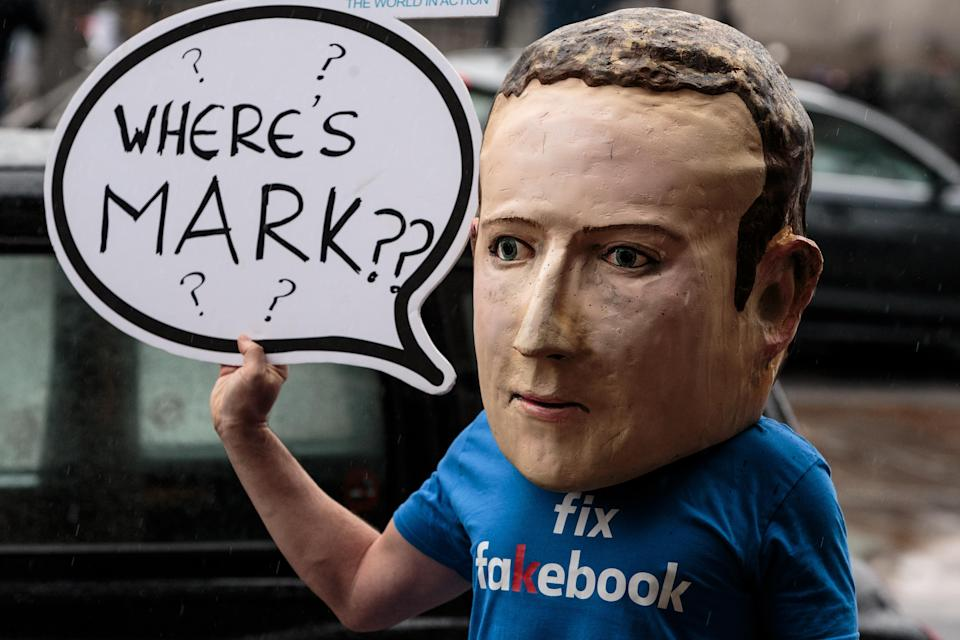 A protester wearing a model head of Facebook CEO Mark Zuckerberg poses for media outside Portcullis House on November 27, 2018 in London, England. Photo: Jack Taylor/Getty Images
