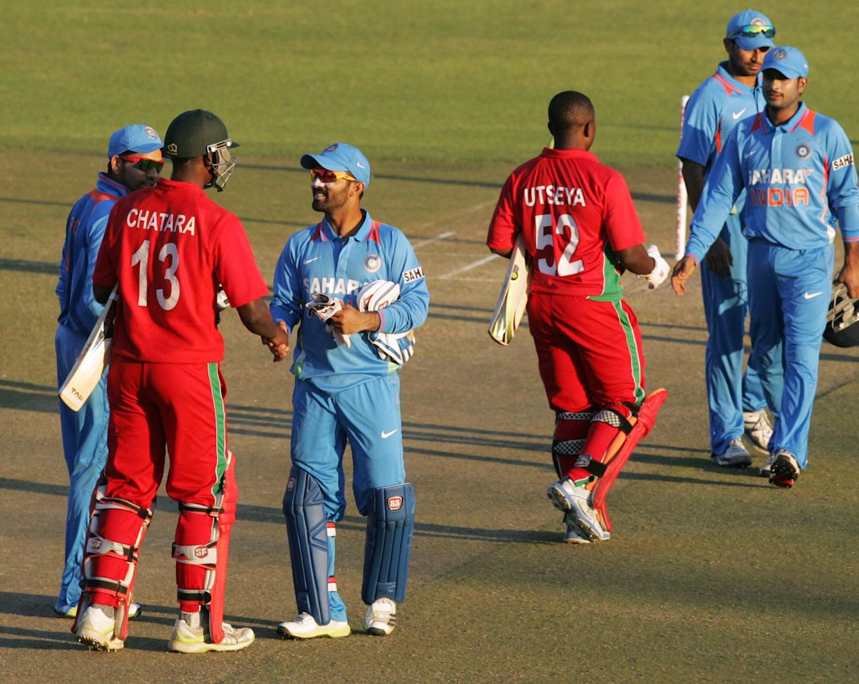 Victorious Indian players shake hands with Zimbabwe's player after winning the second one-day international ODI cricket match of a 5 match series between Zimbabwe and India on July 26 2013 at the Harare Sports Club in Harare.  AFP PHOTO / Jekesai Njikizana        (Photo credit should read JEKESAI NJIKIZANA/AFP/Getty Images)