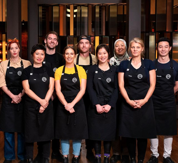 MasterChef contestants in black aprons