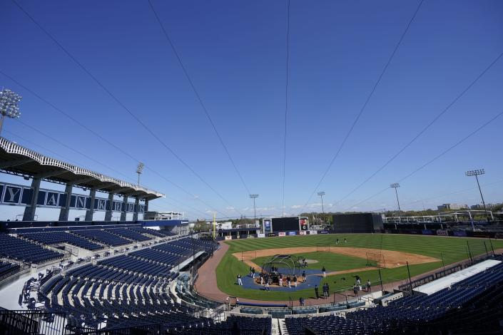 The New York Yankees take batting practice at George M. Steinbrenner Field during a spring training baseball workout Tuesday, Feb. 23, 2021, in Tampa, Fla. (AP Photo/Frank Franklin II)