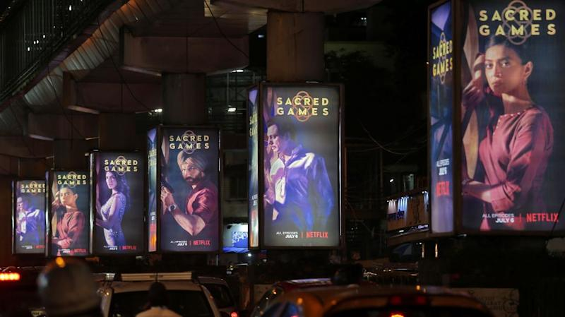 """Traffic moves on a road past hoardings of Netflix's new television series """"Sacred Games"""" in Mumbai, India"""