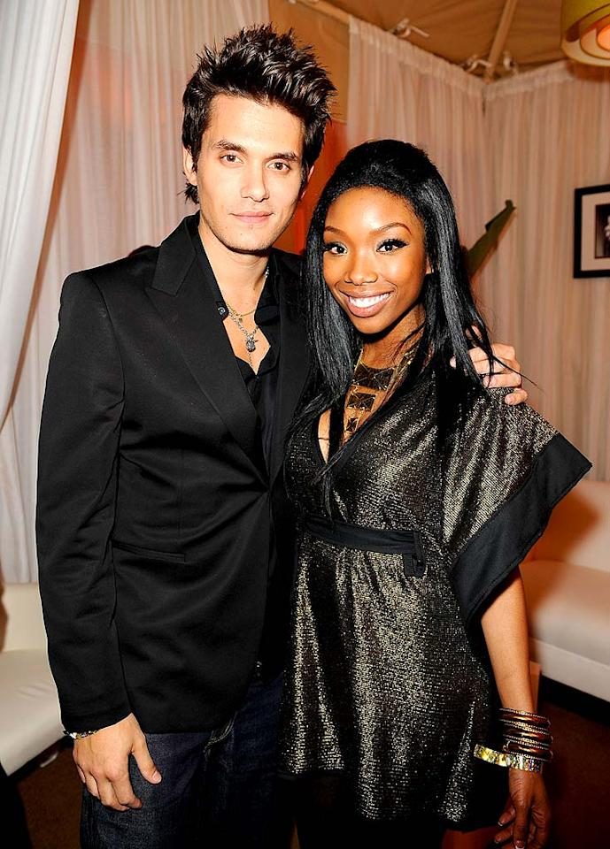 """Brandy apparently made the rounds and was photographed with every hot rocker, including a big-haired John Mayer, at the Sony/BMG bash. Michael Caulfield/<a href=""""http://www.wireimage.com"""" target=""""new"""">WireImage.com</a> - February 10, 2008"""