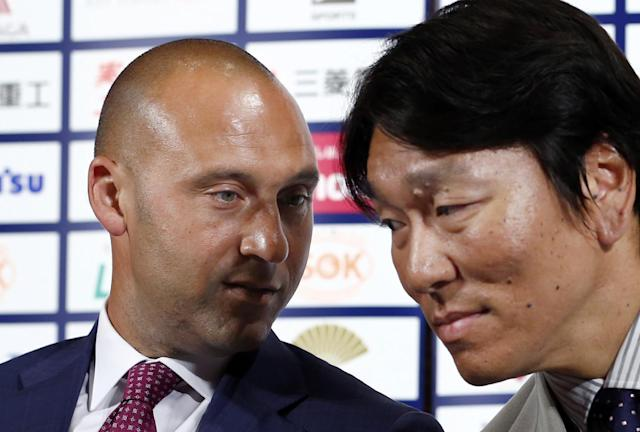 Former NY Yankees Derek Jeter, left, talks with Hideki Matsui during a press conference on a charity baseball game in Tokyo, Wednesday, March 18, 2015. Jeter is teaming up with Matsui to support the survivors of the 2011 earthquake and tsunami - and hinted he may someday get back into baseball as a team owner. The event will be held on Sunday at Tokyo Dome. (AP Photo/Shizuo Kambayashi)