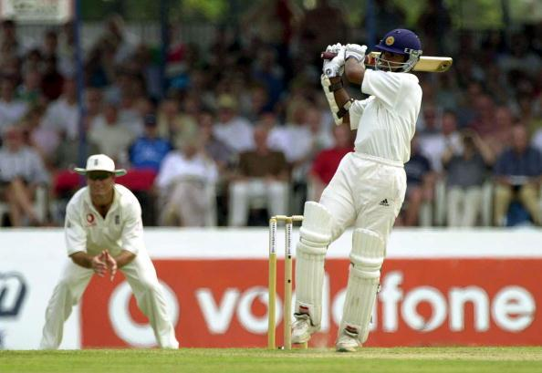 22 Feb 2001:  Kumar Sangakkara of Sri Lanka hits a four as Graeme Hick of England looks on during the first day of the first Test between Sri Lanka and England at the Galle International Cricket Stadium in Galle, Sri Lanka. Digital Image. Mandatory Credit: Tom Shaw/ALLSPORT