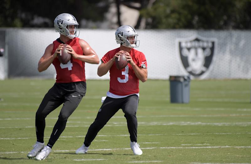 May 28, 2019; Alameda, CA, USA; Oakland Raiders quarterbacks Derek Carr (4) and Nathan Peterman (3) throw the ball during organized team activities at the Raiders practice facility. Mandatory Credit: Kirby Lee-USA TODAY Sports