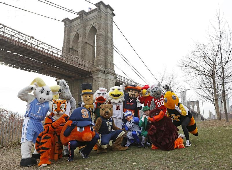 All 15 of the Atlantic Coast Conference's mascots pose for a group photograph, Monday, March 6, 2017, beneath the Brooklyn Bridge in New York. The mascots were promoting the ACC basketball tournament March 7-11 at the Barclays Center in Brooklyn. (AP Photo/Kathy Willens)