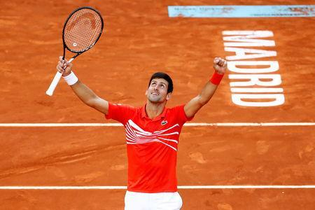 FILE PHOTO: Tennis - ATP 1000 - Madrid Open - The Caja Magica, Madrid, Spain - May 12, 2019 Serbia's Novak Djokovic celebrates winning the final against Greece's Stefanos Tsitsipas REUTERS/Javier Barbancho/File Photo