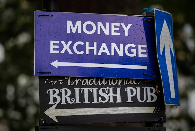 LONDON, ENGLAND - JULY 30: A sign points to a bureau de change and British pub in Kensington as British Pound Sterling has slumped to a 28-month low on July 30, 2019 in London, England. Sterling dropped below $1.23 against the US dollar and fell sharply against the euro to below 1.10 on the international currency markets on Monday, as cabinet ministers began meetings to prepare for a no-deal Brexit. (Photo by Chris J Ratcliffe/Getty Images)