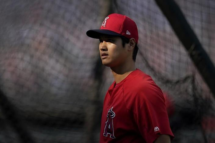 "Shohei Ohtani is relegated to designated hitter for the rest of the season because of a forearm strain. <span class=""copyright"">(Jeff Chiu / Associated Press)</span>"