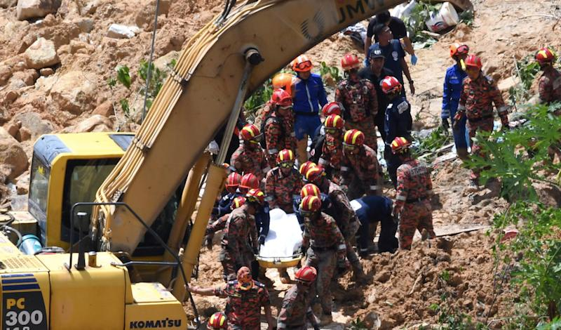 Fire and Rescue Department personnel retrieve a body from the site of a landslide in Paya Terubong, George Town October 20, 2018. — Bernama pic