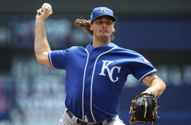 Kansas City Royals pitcher Burch Smith throws against the Minnesota Twins in the first inning of a baseball game Wednesday, July 11, 2018, in Minneapolis. (AP Photo/Jim Mone)