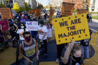 Demonstrators march through Black Lives Matter Plaza as they participate in a Count Every Vote rally, Friday, Nov. 6, 2020, in Washington. (AP Photo/Alex Brandon)