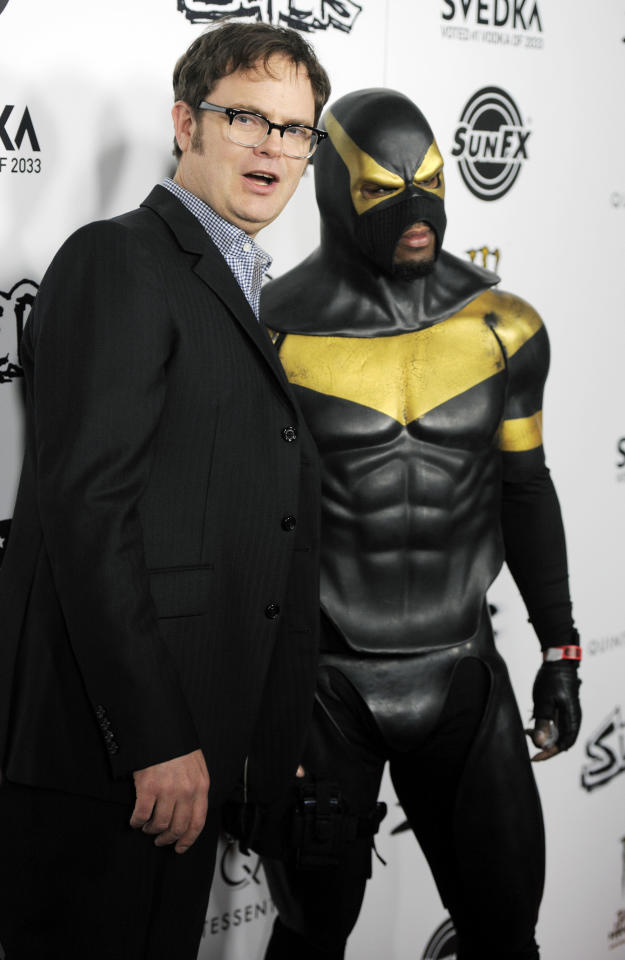 "Rainn Wilson, left, a cast member in ""Super,"" poses with Phoenix Jones, leader of the Rain City Superhero Movement in Seattle, Wash., at the premiere of the film in Los Angeles, Monday, March 21, 2011."