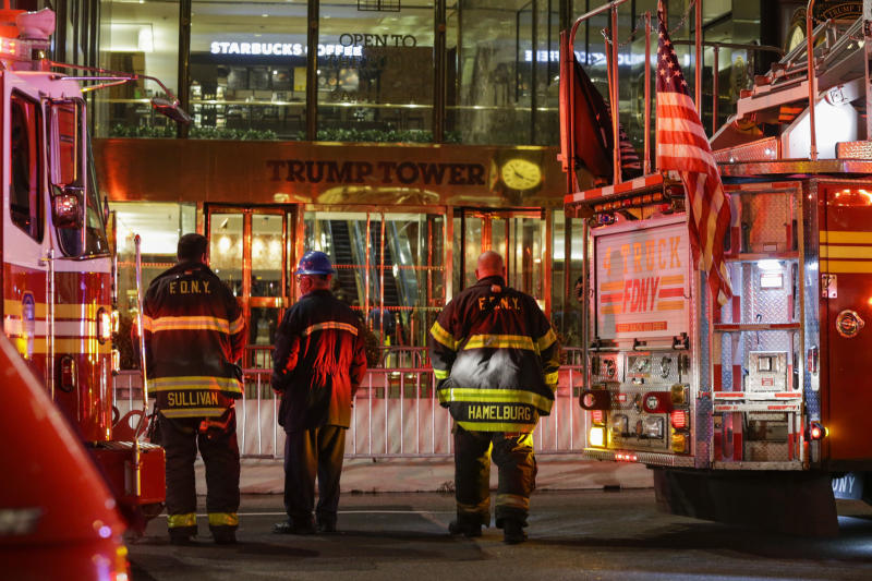 Firefighters at Trump Tower on April 7 in Manhattan. Six firefighters were injured battling the blaze that broke out on the 50th floor. (Eduardo Munoz Alvarez via Getty Images)