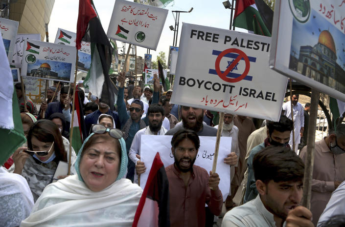 Supporters of the Pakistan Muslim League-N party take part in a rally in support of Palestinians, in Peshawar, Pakistan, Tuesday, May 18, 2021. (AP Photo/Muhammad Sajjad)