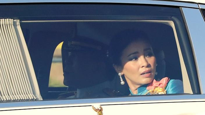 Thailand's king and queen in a royal motorcade in Bangkok, Thailand October 14, 2020.