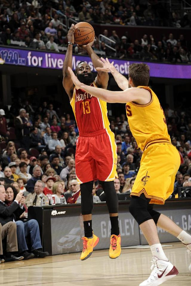 CLEVELAND, OH - MARCH 22: James Harden #13 of the Houston Rockets takes a shot agianst the Cleveland Cavaliers at The Quicken Loans Arena on March 22, 2014 in Cleveland, Ohio. (Photo by David Liam Kyle/NBAE via Getty Images)