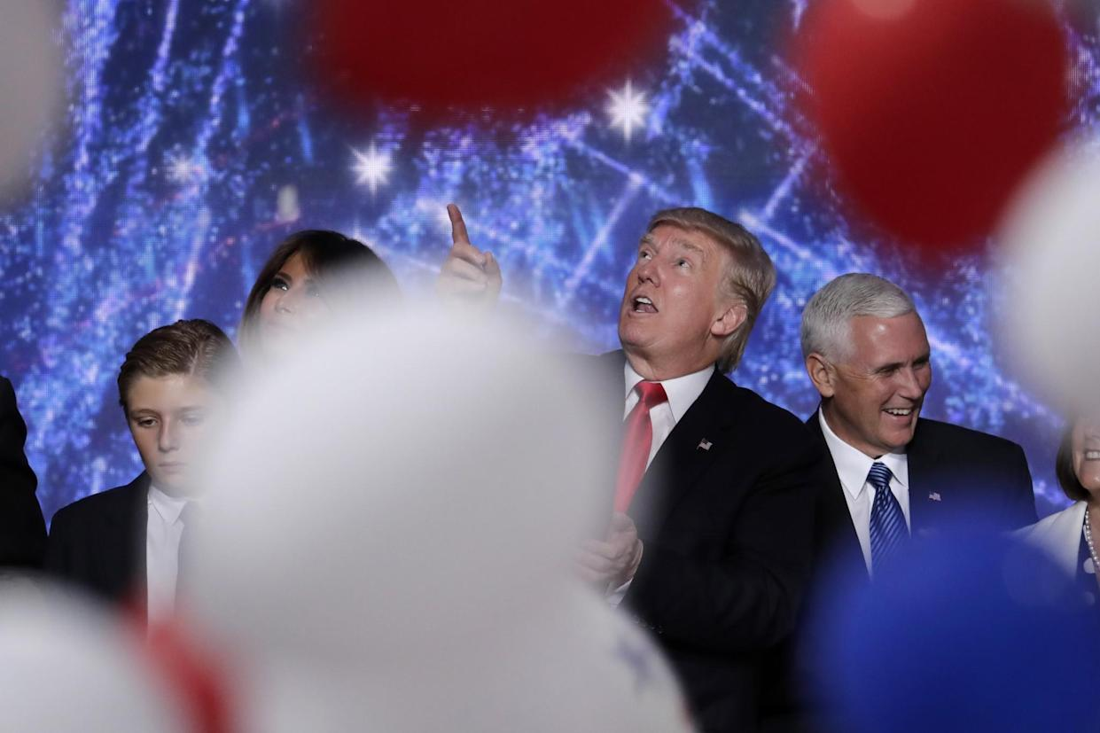 Donald Trump with his son Barron, wife, Melania, and Republican vice presidential nominee Gov. Mike Pence after delivering his acceptance speech at the Republican National Convention in Cleveland, July 21, 2016. (Photo: J. Scott Applewhite/AP)