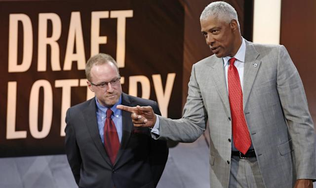 Cleveland Cavaliers general manager David Griffin, left, listens as he speaks on stage with Philadelphia 76ers adviser Julius Irving during the NBA basketball draft lottery in New York, Tuesday, May 20, 2014. (AP Photo/Kathy Willens)