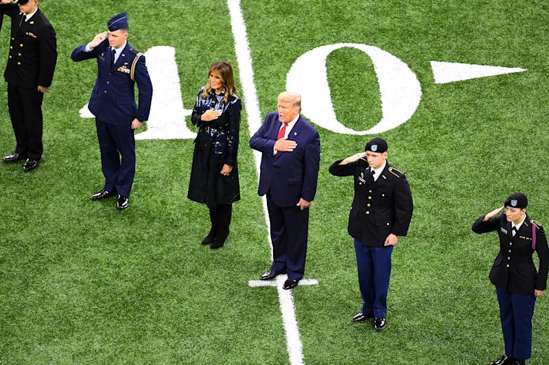 NEW ORLEANS, LA - JANUARY 13: President Donald Trump and first lady Melania Trump sing along to the national anthem at the start of the College Football Playoff National Championship game between the LSU Tigers and the Clemson Tigers at the Mercedes Benz Superdome on January 13, 2020 in New Orleans, Louisiana. (Photo by Jamie Schwaberow/Getty Images)
