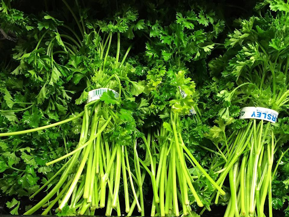 """<p>Fresh herbs can make or break a number of recipes. To keep them fresher longer, wrap cilantro, marjoram, oregano, parsley, rosemary, sage and thyme in damp paper towels and then place them in a zip-top plastic bag. Basil, however, will brown in the fridge; to keep it fresh, put the stems in a jar of water and loosely cover with a plastic bag. If your herbs are already on their way out, don't throw them away; dehydrate them and <a href=""""https://www.thedailymeal.com/drink/low-waste-cocktail-tips?referrer=yahoo&category=beauty_food&include_utm=1&utm_medium=referral&utm_source=yahoo&utm_campaign=feed"""" rel=""""nofollow noopener"""" target=""""_blank"""" data-ylk=""""slk:serve them as a garnish for cocktails"""" class=""""link rapid-noclick-resp"""">serve them as a garnish for cocktails</a>.</p>"""