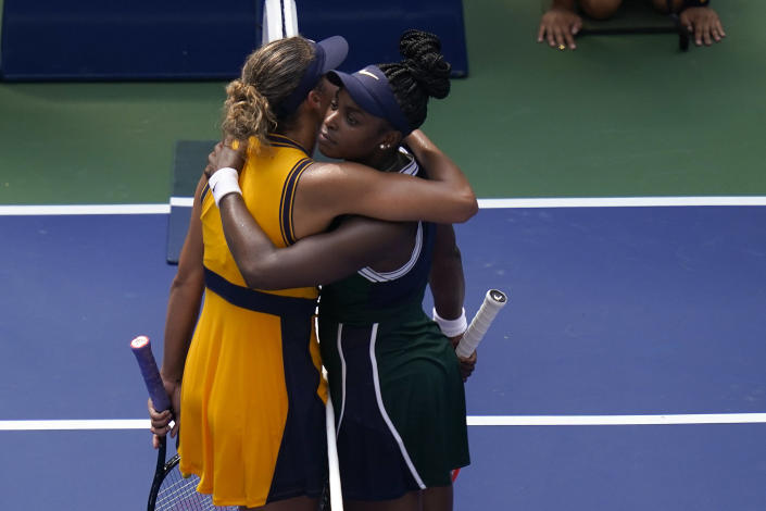 Sloane Stephens, of the United States, right, hugs Madison Keys, of the United States, after winning their first-round match of the US Open tennis championships, Monday, Aug. 30, 2021, in New York. (AP Photo/Seth Wenig)