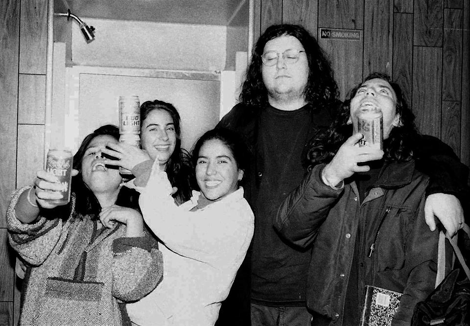 <p>Van Conner, bassist of Screaming Trees, keeps a watchful eye on excited fans who made their way backstage to see Eddie Vedder (R) after Rock for Choice concert at the Hollywood Palladium on January 23, 1993 in Los Angeles.</p>