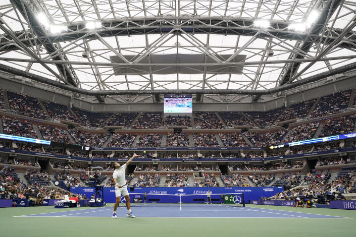 Daniel Evans, of the United Kingdom, serves to Daniil Medvedev, of Russia, during the fourth round of the US Open tennis championships, Sunday, Sept. 5, 2021, in New York. (AP Photo/Seth Wenig)