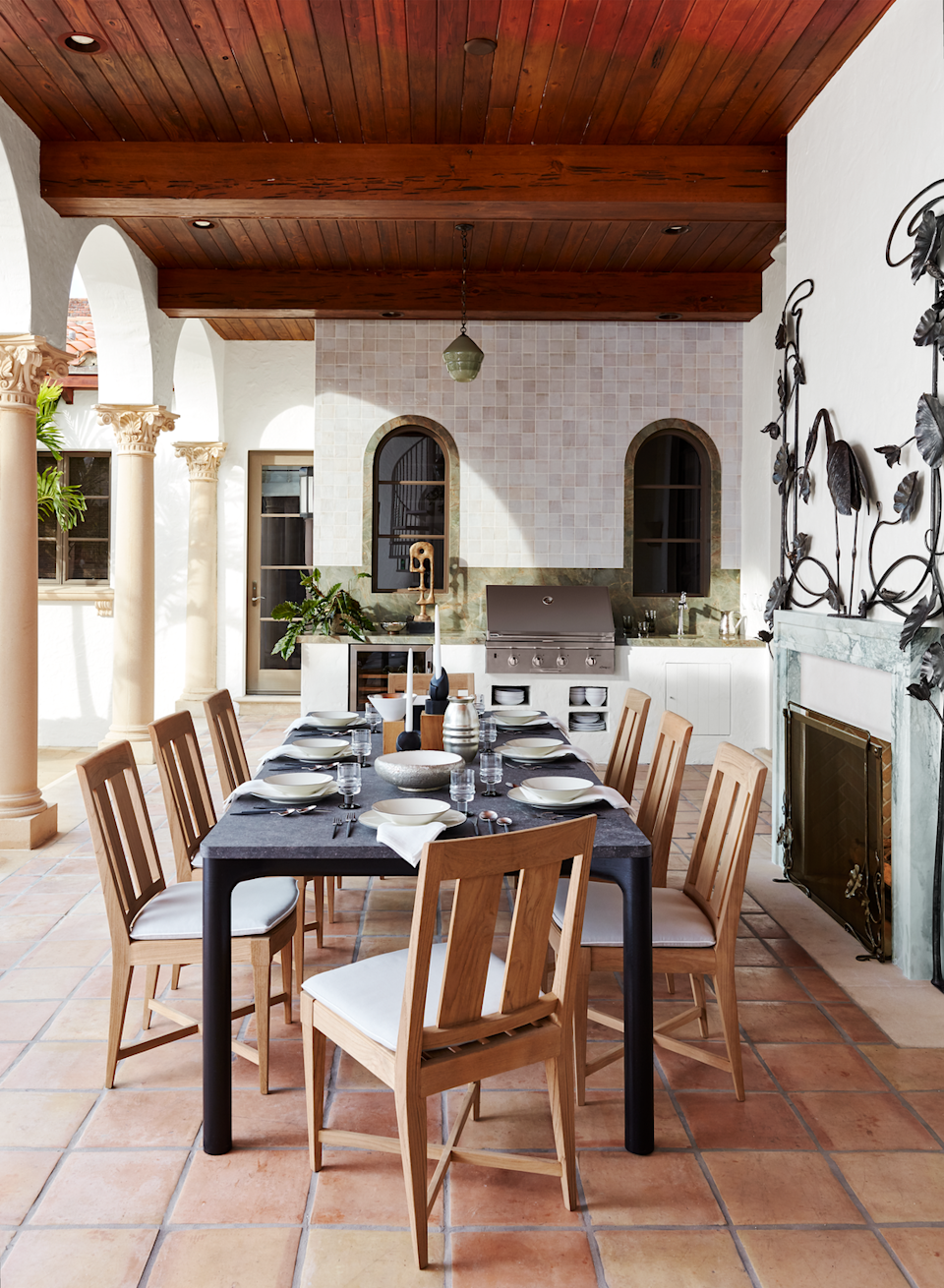 """<p>This Mediterranean-inspired outdoor kitchen and dining space was designed for the <a href=""""https://www.veranda.com/decorating-ideas/g26025165/inside-kips-bay-decorator-show-house/"""" rel=""""nofollow noopener"""" target=""""_blank"""" data-ylk=""""slk:Kips Bay Palm Beach Show House"""" class=""""link rapid-noclick-resp"""">Kips Bay Palm Beach Show House</a> in 2019. California-based designer <a href=""""https://amymeier.com/"""" rel=""""nofollow noopener"""" target=""""_blank"""" data-ylk=""""slk:Amy Meier"""" class=""""link rapid-noclick-resp"""">Amy Meier</a> makes the most of this small space by focusing on the priorities: a stainless grill, sink, built-ins for housing dinnerware, and a wine fridge.</p>"""