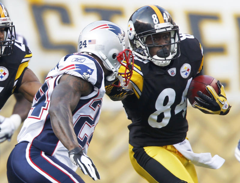 Pittsburgh Steelers' Antonio Brown (84) returns the opening kickoff as New England Patriots Kyle Arrington (24) pursues in the first quarter of the NFL football game on Sunday, Oct. 30, 2011, in Pittsburgh. (AP Photo/Keith Srakocic)