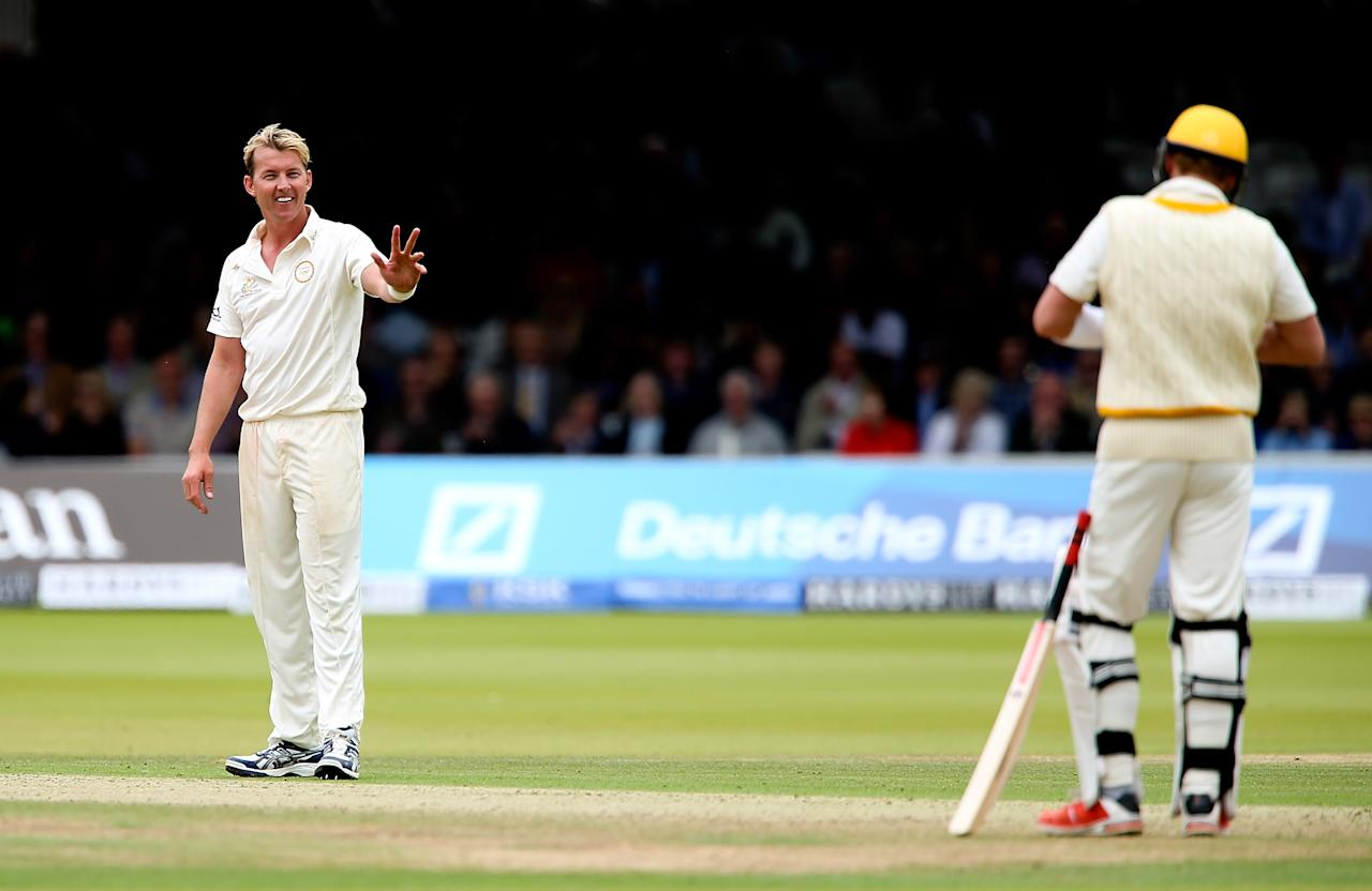 LONDON, ENGLAND - JULY 05: Brett Lee of MCC apologises to Shane Warne of Rest of the World after striking him with a delivery during the MCC and Rest of the World match at Lord's Cricket Ground on July 5, 2014 in London, England.  (Photo by Ben Hoskins/Getty Images)