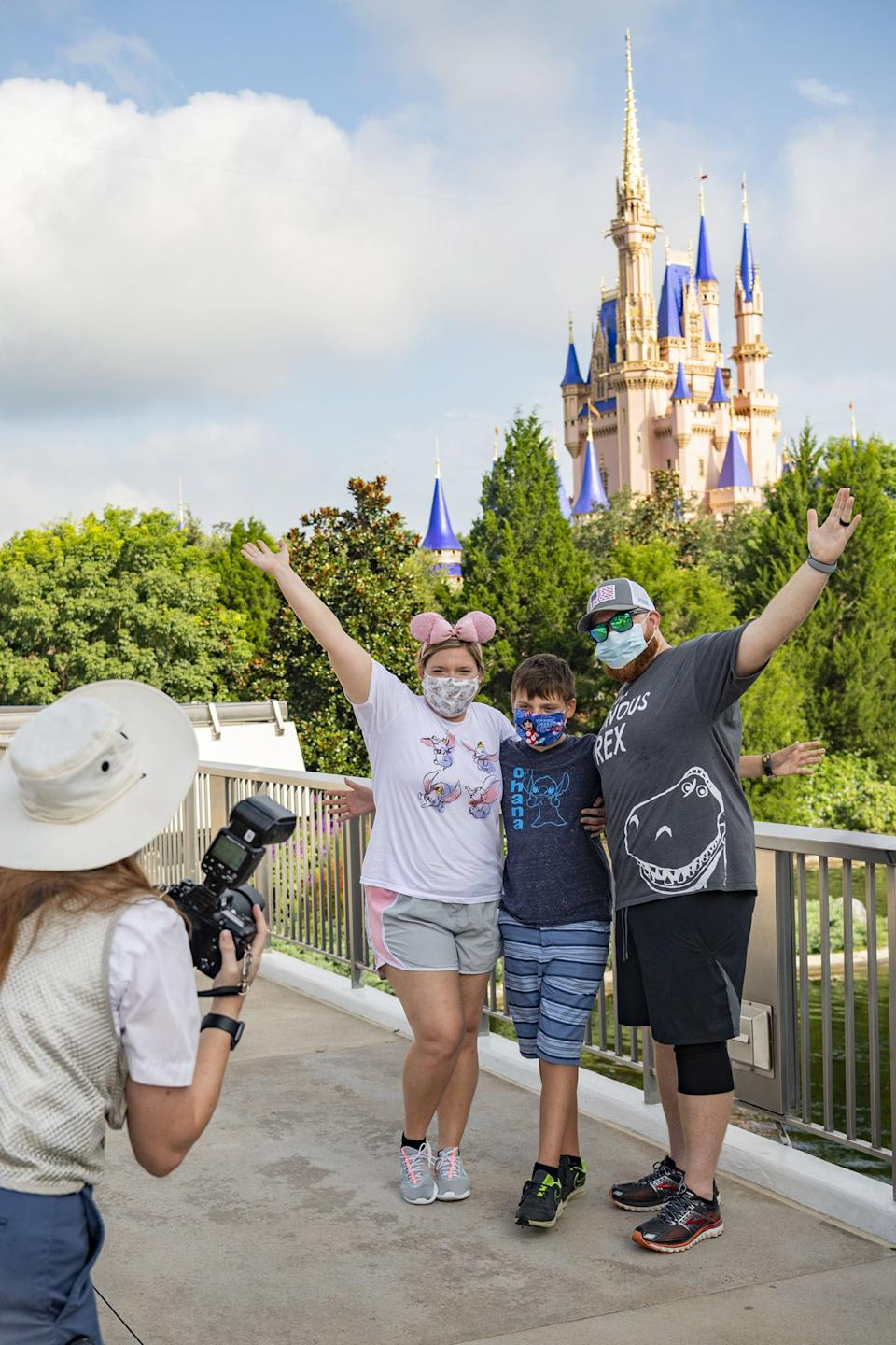 Guests stop to take a photo at Magic Kingdom Park at Walt Disney World Resort on July 11, 2020 in Lake Buena Vista, Florida. July 11, 2020 is the first day of the theme park's phased reopening.Photo by Matt Stroshane/Walt Disney World Resort via Getty Images