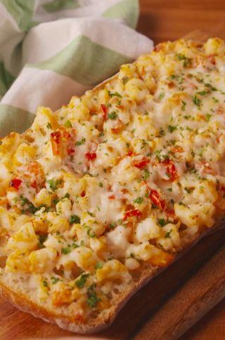 """<p><span>Some people say cheese doesn't go with seafood. We say they haven't tried this bread.</span></p><p>Get the recipe from <a rel=""""nofollow"""" href=""""http://www.delish.com/cooking/recipe-ideas/recipes/a54288/cheesy-shrimp-garlic-bread-recipe/"""">Delish</a>.</p>"""