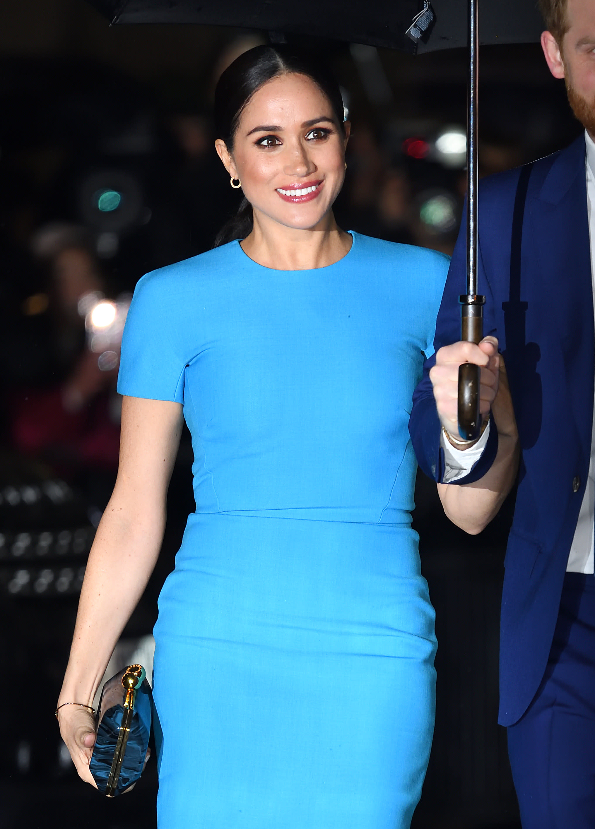 Meghan's Victoria Beckham dress was complimented by a berry lip and sleek knotted ponytail. (Getty Images)