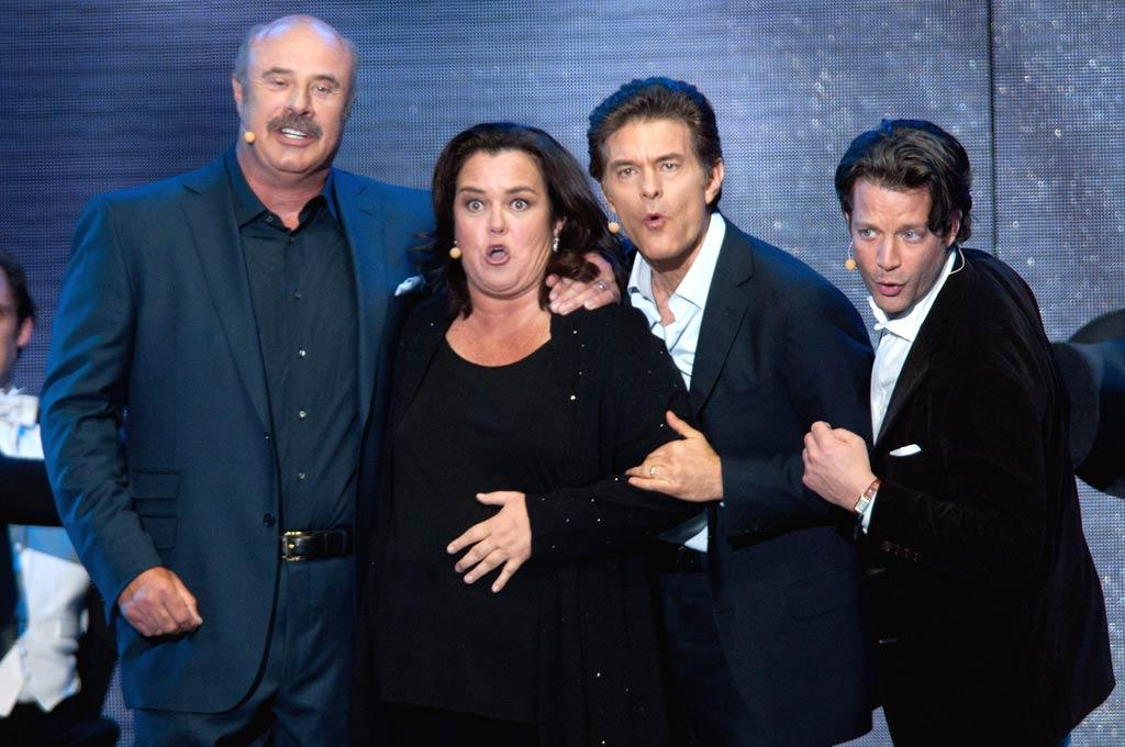 """Rosie O'Donnell sang a ditty with a trio of guys who should be thanking Oprah every day of their lives -- Dr. Phil (left), Dr. Oz (second from right), and Nate Berkus (far right). All three of them got their TV careers off the ground thanks to her. Daniel Boczarski/<a href=""""http://www.gettyimages.com/"""" target=""""new"""">GettyImages.com</a> - May 17, 2011"""