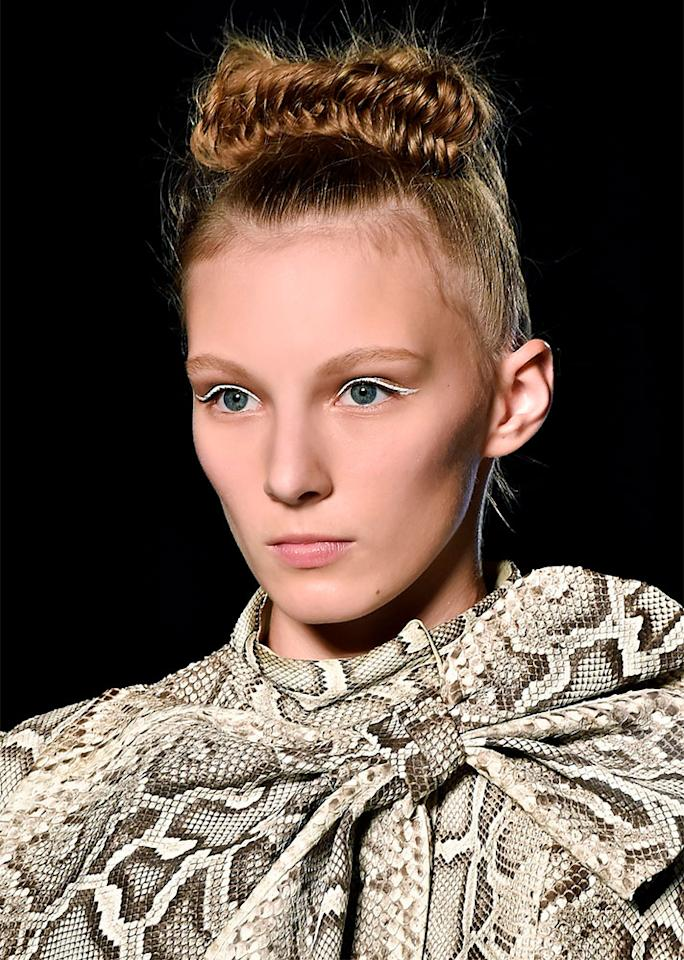 For longer strands, get fancy with a fishtail topknot.