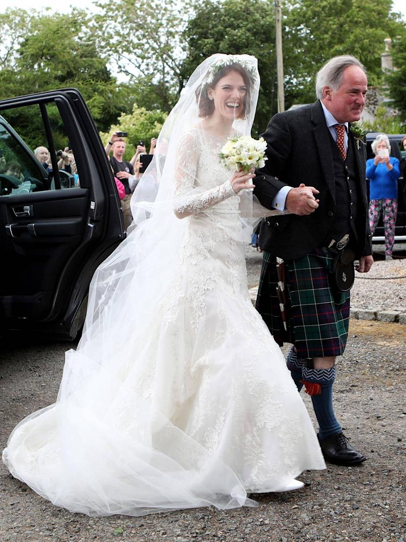 Rose Leslie with her father Sebastian Leslie arrive at Rayne Church, Kirkton of Rayne in Aberdeenshire (Jane Barlow/PA)