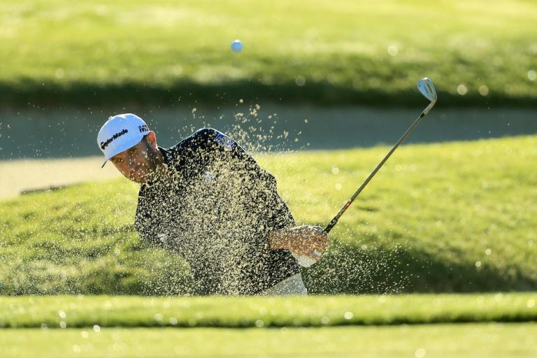 Dustin Johnson, shown in this February 8, 2018 photo, had just one bogey as he gained ground on co-leader Beau Hossler