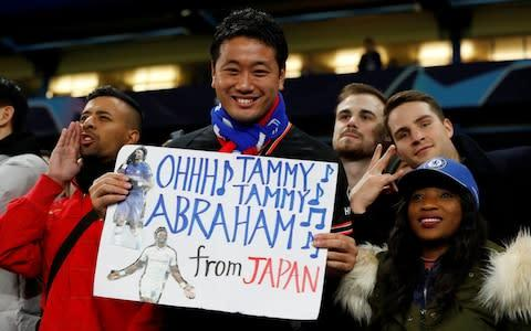 <span>A fan holds a sign referencing Chelsea's Tammy Abraham</span> <span>Credit: Reuters </span>