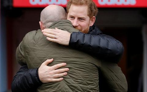 <span>The Duke of Sussex is greeted by former Welsh rugby player Gareth Thomas</span> <span>Credit: PETER NICHOLLS/POOL/AFP </span>