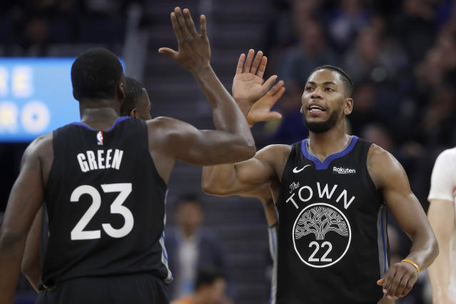 Golden State Warriors forward Glenn Robinson III (22) celebrates with forward Draymond Green (23) during the first half of the team's NBA basketball game against the Chicago Bulls in San Francisco, Wednesday, Nov. 27, 2019. (AP Photo/Jeff Chiu)