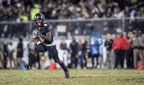 Central Florida running back Adrian Killins Jr. (9) breaks into the open field during the first half of the team's NCAA college football game against South Florida, Friday, Nov. 29, 2019, in Orlando, Fla. (AP Photo/Willie J. Allen Jr.)