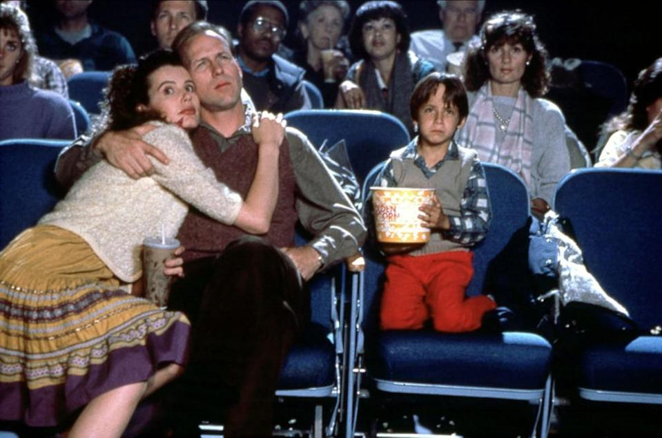 Davis with William Hurt and Robert Gorman in the 1988 film The Accidental Tourist.