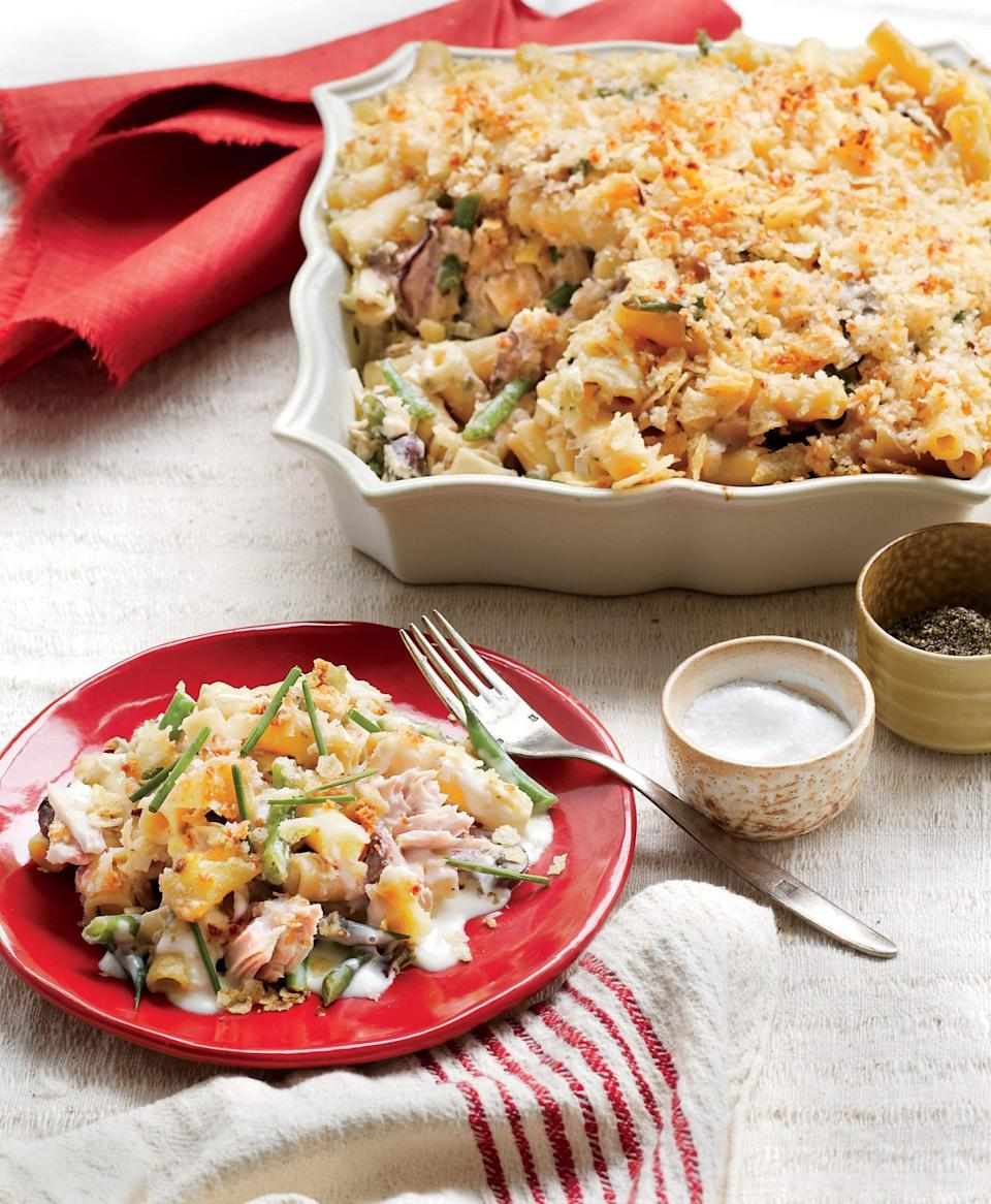 """<p><strong>Recipe: <a href=""""https://www.southernliving.com/recipes/tuna-casserole"""" rel=""""nofollow noopener"""" target=""""_blank"""" data-ylk=""""slk:New Tuna Casserole"""" class=""""link rapid-noclick-resp"""">New Tuna Casserole</a></strong></p> <p>Crushed potato chips give this cheesy casserole a crunchy finish that the whole family will love. </p>"""